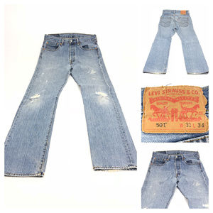 Levis 501 button fly distressed jeans